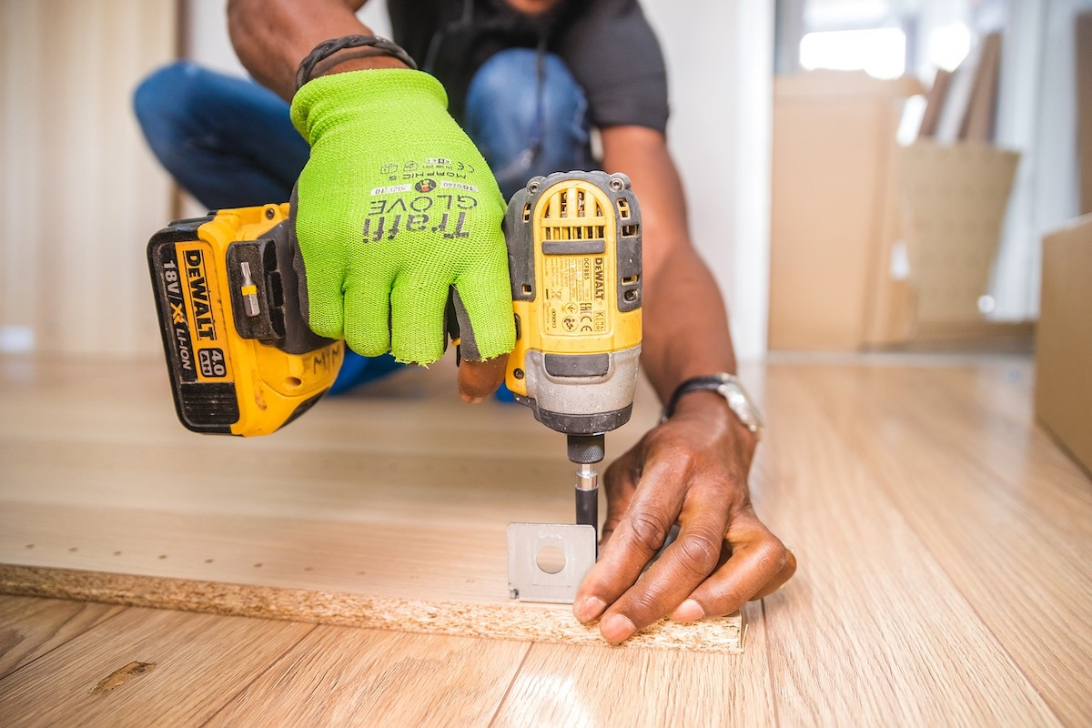 Man Uses a Power Drill at Home Salisfy Future of Shopping Tool Brands