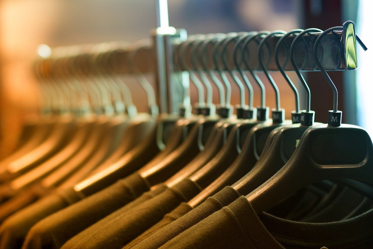 Olive Shirts Displayed on a Clothing Rack Salsify D2C Apparel Brand Challenges